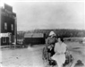 Doc Susie (wearing bonnet) in buggy with unidentified woman
