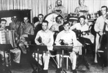 Black and white image of POW playing in a band