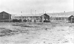 Black and white image of three barracks building on POW camp
